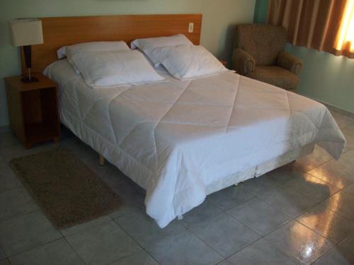 Кровать или кровати в номере Presidente Hotel