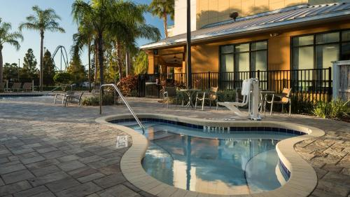 The swimming pool at or near Fairfield Inn Suites by Marriott Orlando At SeaWorld