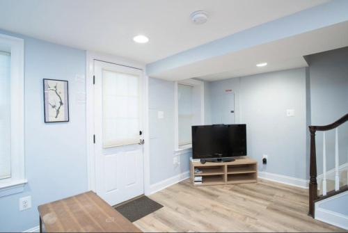 A television and/or entertainment center at Sunny DC oasis w/ free parking!
