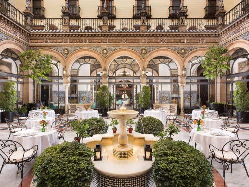 A restaurant or other place to eat at Hotel Alfonso XIII, a Luxury Collection Hotel, Seville