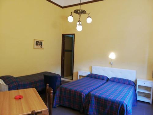 Кровать или кровати в номере Hotel Belvedere