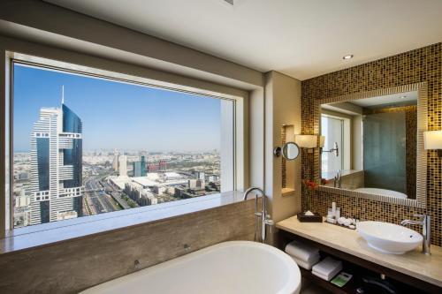A bathroom at Millennium Plaza Hotel
