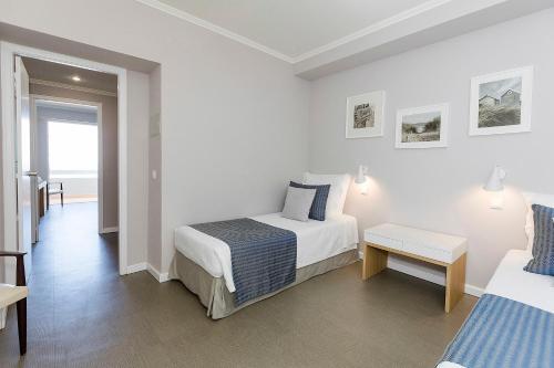 Cama o camas de una habitación en Arribas Sintra Hotel