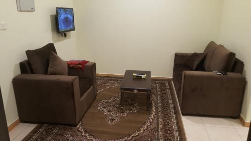 Uma área de estar em Al Eairy Apartments - Jazan 3