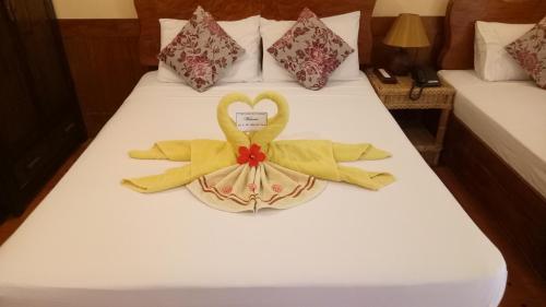 A bed or beds in a room at El Nido Garden Resort