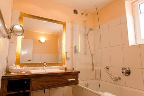 Ein Badezimmer in der Unterkunft Hotel Heide Kröpke