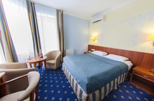 Кровать или кровати в номере Отель Яхт Клуб Новый Берег