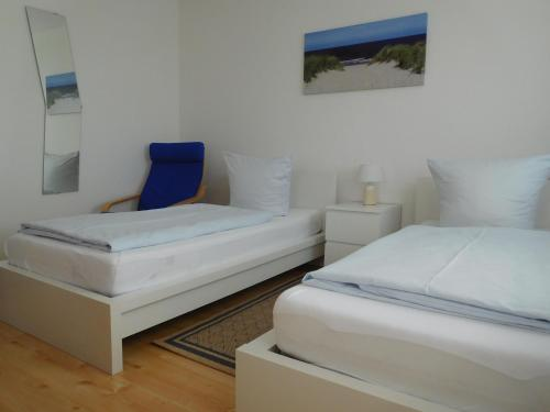 A bed or beds in a room at Arkadia Hotel