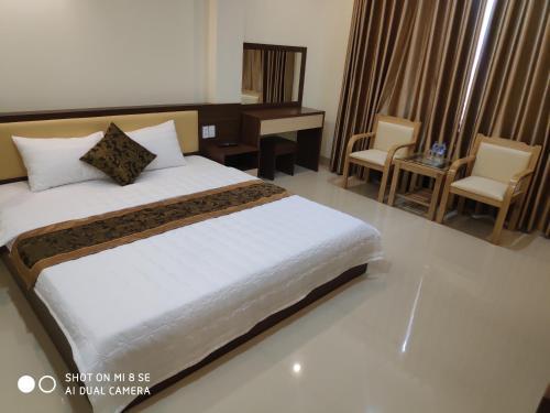 Кровать или кровати в номере Ngọc Anh Hotel