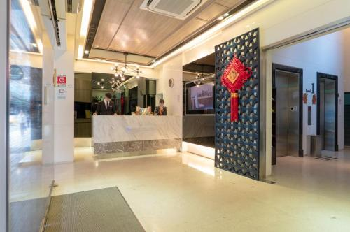 The lobby or reception area at Wallsun Hotel