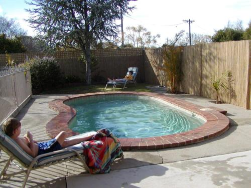 The swimming pool at or near Country Home Motor Inn