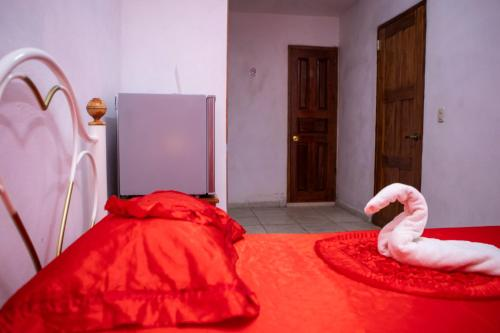 A bed or beds in a room at B&B La Reina