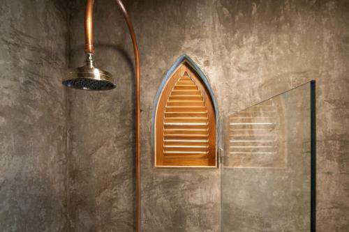 A bathroom at The Nomadic Hotel