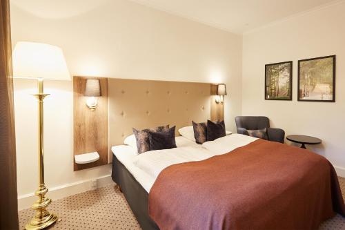 Postelja oz. postelje v sobi nastanitve Hotel Vejlefjord