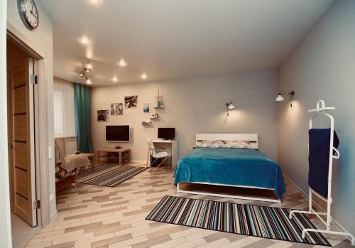 Кровать или кровати в номере Орёл&Решка4