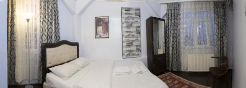 Ein Bett oder Betten in einem Zimmer der Unterkunft Metropolis Hostel & Guest House
