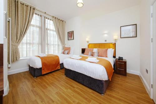 A bed or beds in a room at Imperial Guest House Ltd.