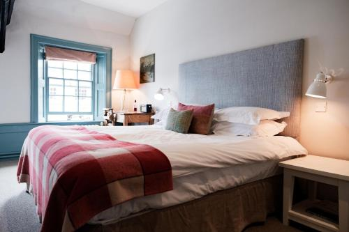 A bed or beds in a room at Bel and The Dragon-Odiham