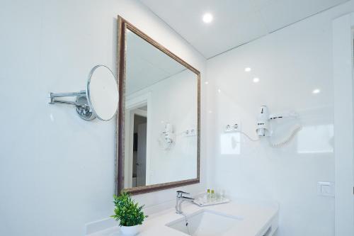 Een badkamer bij Hotel Suite Montana Club