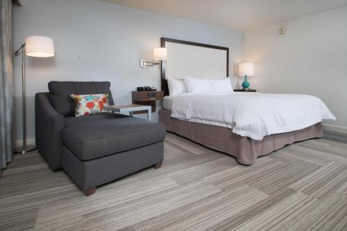 A bed or beds in a room at Hampton Inn Tiffin