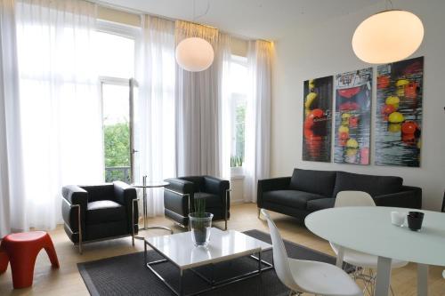 Ein Sitzbereich in der Unterkunft Leopold5 Luxe-Design Apartment