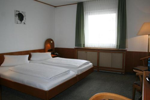 A bed or beds in a room at Sam Pension - MyRoom