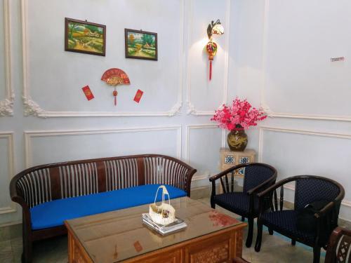 Ein Sitzbereich in der Unterkunft Angsana Hotel Melaka