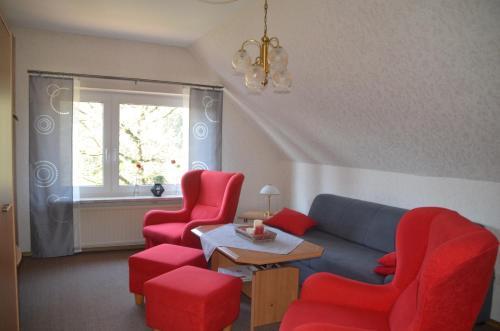 Ein Sitzbereich in der Unterkunft Grensemann, Ferienwohnung