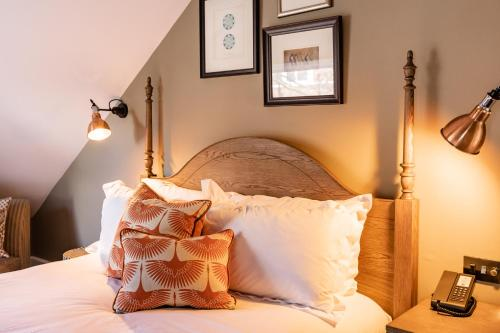 A bed or beds in a room at Didsbury House Hotel