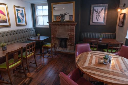 A restaurant or other place to eat at White Hart Inn
