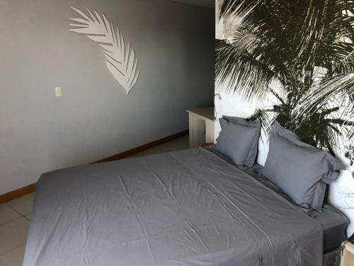 A bed or beds in a room at Studio particular em Hotel