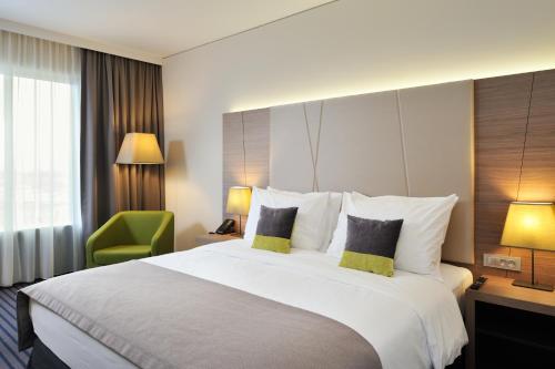 Łóżko lub łóżka w pokoju w obiekcie Radisson Blu Plaza Hotel Ljubljana