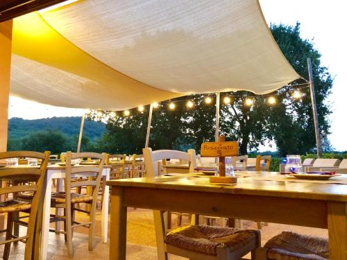 A restaurant or other place to eat at Agriturismo Ristorante Monte Argentario