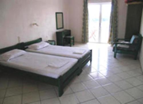 Säng eller sängar i ett rum på Kolios Beach Seaview Studios
