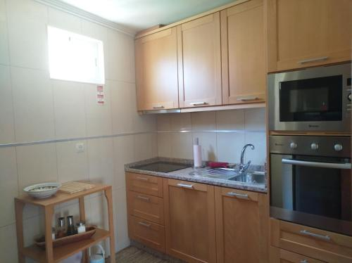 A kitchen or kitchenette at Casa D. Antónia