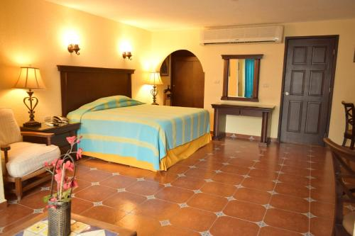 A bed or beds in a room at Hotel Valles