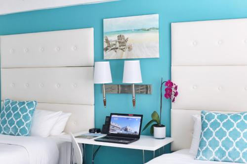 A television and/or entertainment center at Beacon South Beach Hotel
