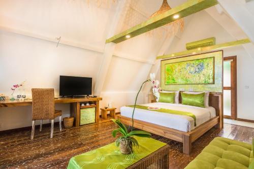Letto o letti in una camera di Pearl of Trawangan
