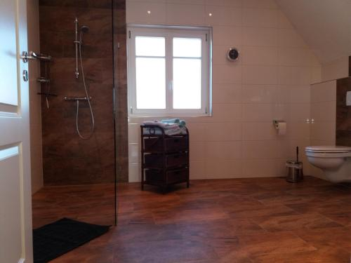 Ванная комната в Ferienwohnung Sommer
