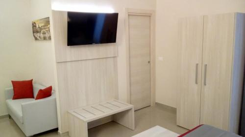 A television and/or entertainment center at Hotel Bel Soggiorno
