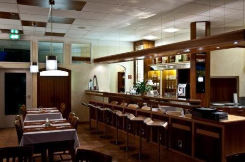 Lounge oder Bar in der Unterkunft Hotel Manu