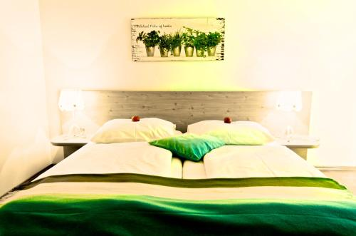 A bed or beds in a room at Zur Steirerstub'n