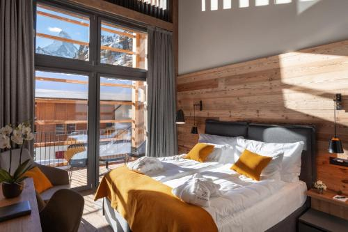 A bed or beds in a room at 22 Summits Boutique Hotel