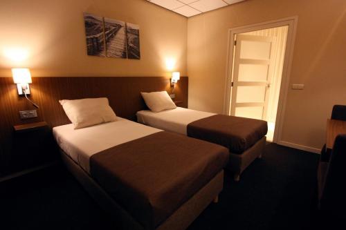 Кровать или кровати в номере Hotel Restaurant De Bengel