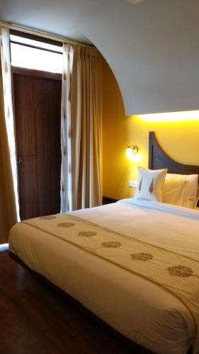 A bed or beds in a room at Ekaa Villa - A Boutique Hotel