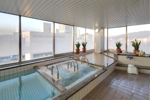 The swimming pool at or near Ark Hotel Hiroshimaeki Minami