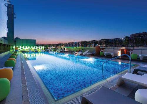 The swimming pool at or close to Studio M Arabian Plaza Hotel & Hotel Apartments by Millennium