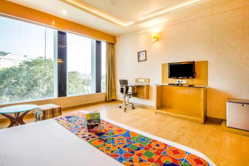A television and/or entertainment center at Jaipur CM-A Luxury Boutique Hotel