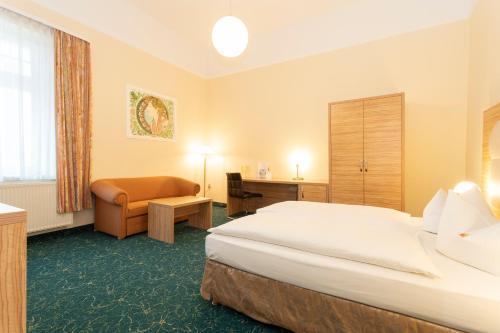 Ein Bett oder Betten in einem Zimmer der Unterkunft Palais am Kleistpark