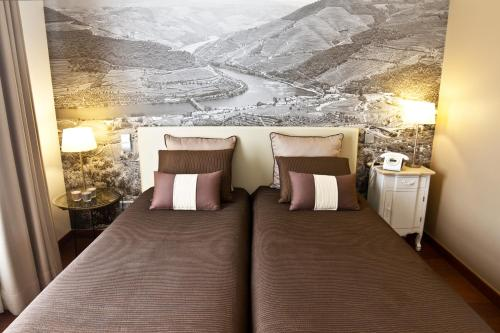 Uma cama ou camas num quarto em Ribeira do Porto Hotel